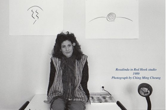Rosalinda Kolb with drawings, Red Hook, Brooklyn, 1989.  Photograph by Ching Ming Cheung.