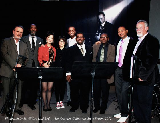 "Pictured (from left to right) at the San Quentin concert: James Egan, producer; Ron Carter, bass; Grace Kelly, alto sax; N. C. Heiken, director; Mark Gross, alto sax; Marvin ""Smitty"" Smith, drums; George Cables, piano; Delfeayo Marsalis, trombone; Michael Connelly, executive producer; photograph by Terrill Lee Lankford."